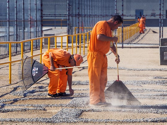 Inmates work inside the Arizona State Prison-Kingman