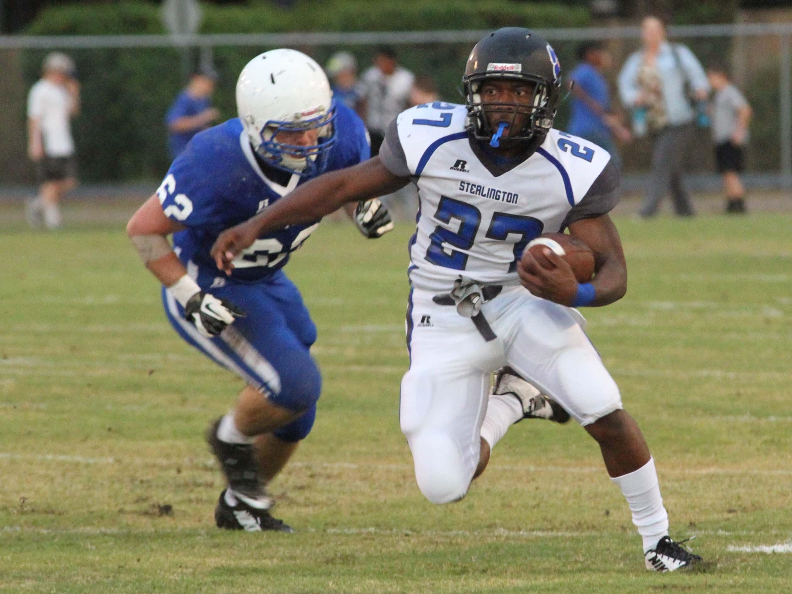 Sterlington's DeVante Douglas (27) carries the ball for the Panthers in first half action against the St. Frederick Warriors Friday night in Monroe.