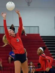 St. Lucie West Centennial's Erin Ergle sets the ball