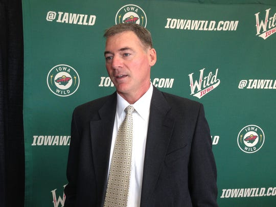 Kurt Kleinendorst talks to reporters after he was formally introduced as the first head coach of the Iowa Wild on July 22, 2013.