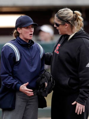 From Feb. 16, 2019, Rutgers head coach Kristen Butler, right, argues a call with the home plate umpire during an NCAA college softball game against Texas A&M in College Station, Texas. On Tuesday, June 2, 2020, the results of a seven-month investigation into allegations of physical and emotional abuse in the Rutgers University softball program has found examples of inappropriate behavior but stops short of imposing discipline on the coaches. The probe released followed allegations that Butler and assistant coach Marcus Smith, her husband, fostered a climate of fear, intimidation and abuse.