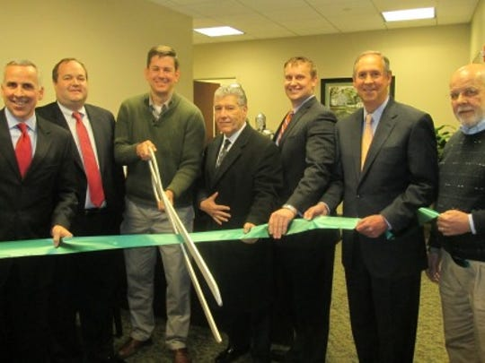 Alliance Wealth Management Group recently opened in Raritan Township. Pictured from left to right are Thomas McCabe of Alliance Wealth; Christopher Phelan, president-CEO of Hunterdon County Chamber of Commerce; Mayor Craig O'Brien; Raritan Committee Michael Mangin; Steven M. Fox and Steven Linden of Alliance Wealth Management Group; and George Ditzler, president-CEO of TeamLinkHR and member of the Chamber board.