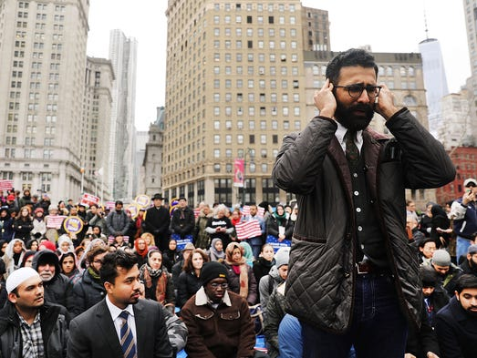 Area Muslims and local immigration activists participate
