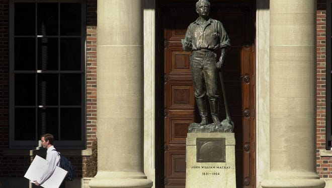 A statue of John Mackay stands on the UNR campus.