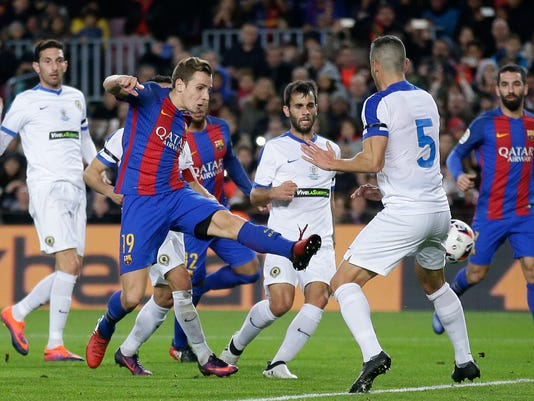 FC Barcelona's Lucas Digne, second left, kicks the ball to scores during the Copa del Rey, Spain's King's Cup soccer match between FC Barcelona and Hercules at the Camp Nou in Barcelona, Spain, Wednesday, Dec. 21, 2016. (AP Photo/Manu Fernandez)