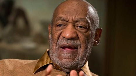 """In this file photo, entertainer Bill Cosby gestures during an interview about the upcoming exhibit, """"Conversations: African and African-American Artworks in Dialogue, """" at the Smithsonian's National Museum of African Art, in Washington. Cosby testified under oath in 2005 that he gave a tabloid an exclusive about sex-assault allegations made by a Canadian woman against him so it would spike a second accuser's story. The Associated Press on Wednesday obtained excerpts from Cosby's 2005 deposition from federal court files unsealed in Philadelphia."""