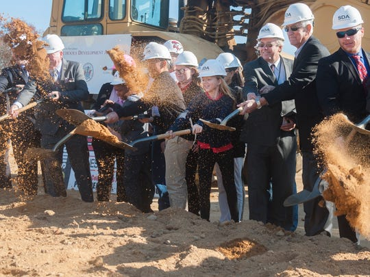 Rossi Intermediate School students join officals during a ceremonial groundbreaking for the Lincoln Avenue Middle School in Vineland on Thursday.  11.17.16