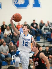 Crestline's Kaden Ronk puts up a layup against Lucas.