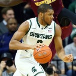 Michigan State Spartans forward Marvin Clark Jr. (0) drives to the basket against Minnesota Golden Gophers guard Carlos Morris (11) during the 1st half of a game at Jack Breslin Student Events Center.