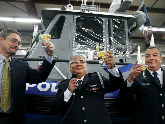 From left, SAFE Boats International CEO Dennis Morris,