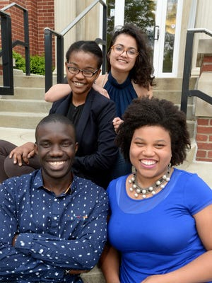 Earlham College students Wyclife Omondi, Leslie Ossete, Sonia Kabra and Iman Cooper are Team Magic Bus and one of six remaining entrants out of 25,000 for the Hult Prize.