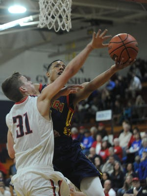 Desmond Bane of Seton Catholic shoots over Blue River's Jonah Madison during Friday's sectional semifinal at Blue River.