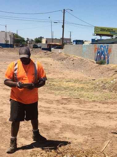 Graffiti Buster Greg Strong uses an iPad to review a graffiti complain near 34th Avenue and Roanoke Drive.