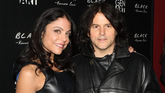 """In a Jan. 17, 2009 file photo, chef Kerry Simon, right, and Bethany Frankle attend the Sundance Kenneth Cole Black Party, in Park City, Utah. Simon, a former """"Iron Chef"""" champ who served up dishes to rock bands such as Led Zeppelin and Mötley Crüe, died Friday morning, Sept. 11, 2015, in Las Vegas, says his business partner Cory Hawell. He was 60."""