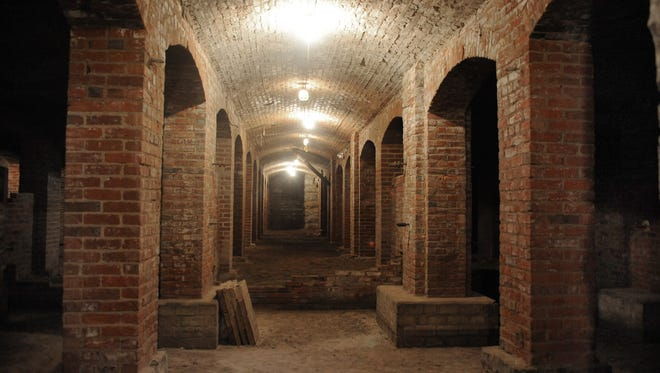 The catacombs dating to the 1880s underneath Indianapolis' City Market. The brick archways, limestone columns and cavernous walkways span 20,000 square feet underground and were part of Tomlinson Hall.