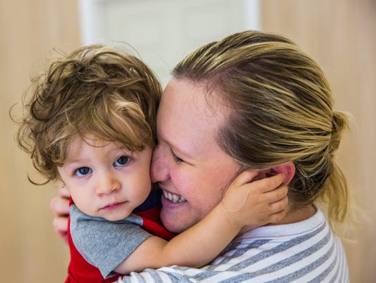 Nicole Perrotta, of Naples, dances with her son Mason,
