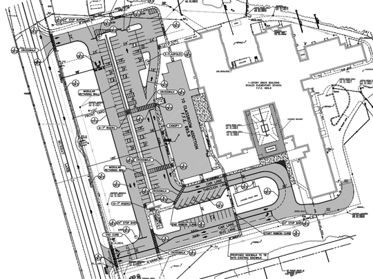 Site plan of the proposed addition and new parking spaces for Scales Elementary School.