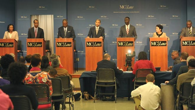 Jackson mayoral candidates Regina Quinn, from left, Melvin Priester Jr., Harvey Johnson Jr., Chokwe Antar Lumumba, Tony Yarber, Margaret Barrett-Simon and John Horhn discuss issues during Friday's mayoral debate hosted by The Clarion-Ledger, WAPT-TV and the Mississippi College School of Law.