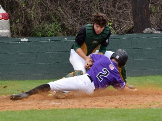 Menard's catcher Jonathan Levassuer (44, back) tags Rosepine's Kody Phillips (2, front) out at home plate.