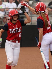 Pacelli's Paige Hintz was the first player to cross home plate for Pacelli and is congratulated by Christonna Shafranski.  Shiocton played Pacelli in the WIAA Division 4 Semifinal softball game at UW's Goodman Diamond, Madison, Wis., June 9, 2017.  Pacelli beat Shiocton 3 - 0.