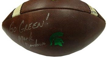 The ball that is being sold is signed by Mark Dantonio.