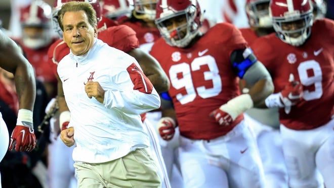 Alabama Crimson Tide head coach Nick Saban leads his team onto the field for the game against the LSU Tigers at Bryant-Denny Stadium.