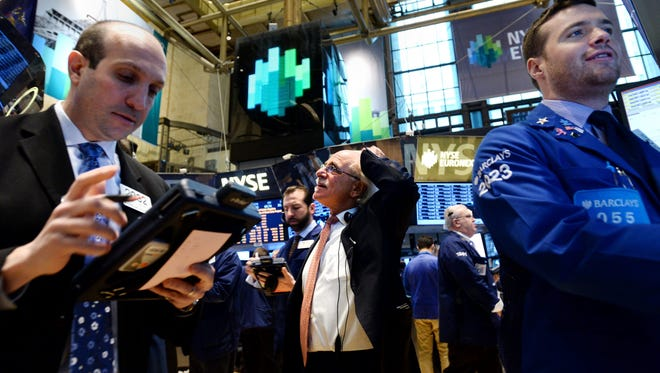 Traders work on the floor of the New York Stock Exchange at the start of the trading day on March 3, 2014.