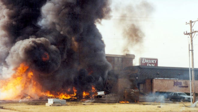 Fire engulfs the C-130 plane that crashed into the former JoJo's restaurant and the Drury Inn following the crash of the plane on Feb. 6, 1992.
