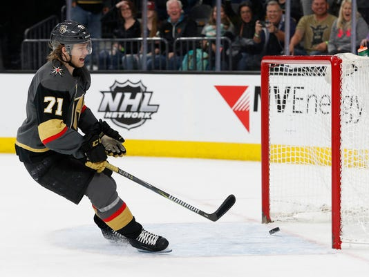 Vegas Golden Knights center William Karlsson scores against the Colorado Avalanche during the third period of an NHL hockey game, Monday, March 26, 2018, in Las Vegas. Vegas won 4-1. (AP Photo/John Locher)