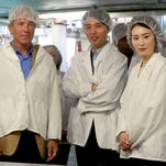 Rep. Kurt Schrader (from left), Wontae Ahn, the director of strategic purchasing with the Korean company G & L Food, and Jung Sun Hee, the president of the Korean company Sulbing, are given a factor tour by Oregon Fruit Products General Manager Patti Law during an international trade meeting at Oregon Fruit Products in West Salem on Thursday, May 28, 2015.