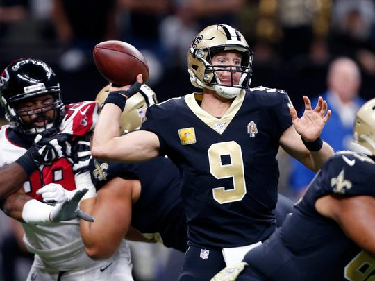 New Orleans Saints quarterback Drew Brees (9) passes under pressure from Atlanta Falcons defensive end Adrian Clayborn (99) in the first half of an NFL football game in New Orleans, Sunday, Nov. 10, 2019. (AP Photo/Butch Dill)