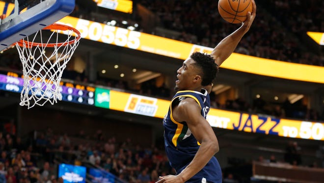 FILE - In this Oct. 28, 2017, file photo, Utah Jazz guard Donovan Mitchell dunks in the second half during an NBA basketball game against the Los Angeles Lakers in Salt Lake City. Mitchell will compete in the Slam Dunk contest during NBA All-Star weekend in Los Angeles after Orlando Magic forward Aaron Gordon left because of a hip injury. (AP Photo/Rick Bowmer, File)