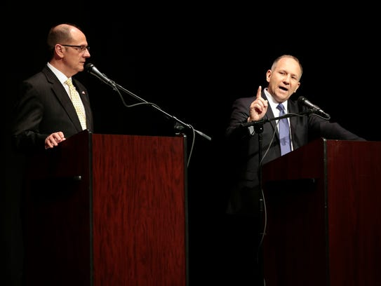 U.S. Rep. Lloyd Smucker, R-Pa., right, answers a question from the moderators and audience members during a debate Monday, April 30, 2018, with Republican Chet Beiler on at Columbia High School.