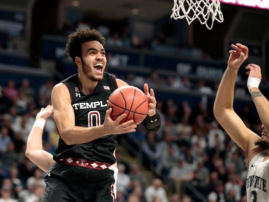 Temple's Obi Enechionyia (0) goes to the basket as Penn State's Satchel Pierce (3) defends during the first half of an NCAA college basketball game in the first round of the NIT in State College, Pa., Wednesday, March 14, 2018. (AP Photo/Chris Knight)