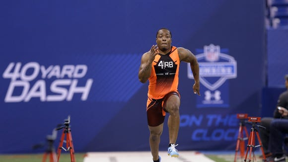 Auburn running back Cameron Artis-Payne runs the 40-yard dash at the NFL football scouting combine in Indianapolis, Saturday, Feb. 21, 2015. (AP Photo/David J. Phillip)
