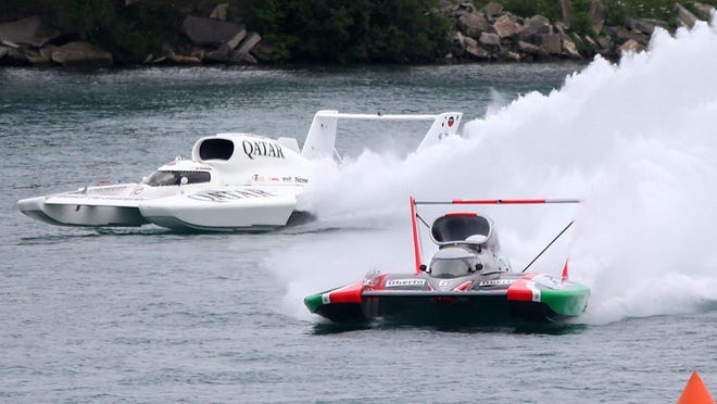 The Oberto boat driven by Jimmy Shane and the Team Red Dot/Spirit of Qatar boat driven by Jon Zimmerman go through the Rooster Tail turn during qualifying for the Detroit APBA Gold Cup Race on Saturday,July 12, 2014 in Detroit Michigan. Zimmerman would flip his boat at the Belle Isle turn during this qualifier. Kirthmon F. Dozier/Detroit Free Press