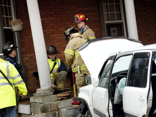 """Lebanon crash: City firefighters examine a porch at the home of Margaret Ditzler, 1201 Colebrook Road, that was damaged by a Honda CRV shortly after 3:30 p.m. Friday. Ditzler said she was inside her house when she heard the crash. """"I knew exactly what happened,"""" she said, explaining her home was hit twice by vehicles in 2012. Justin Hess of Manheim, who witnessed the accident, said the Honda, driven by a woman who is seven months pregnant, was driving east on Colebrook Road when her vehicle went across the road, struck a curb and hit the corner of the porch. The woman, whose name was not immediately available from police, was taken to Hershey Medical Center."""