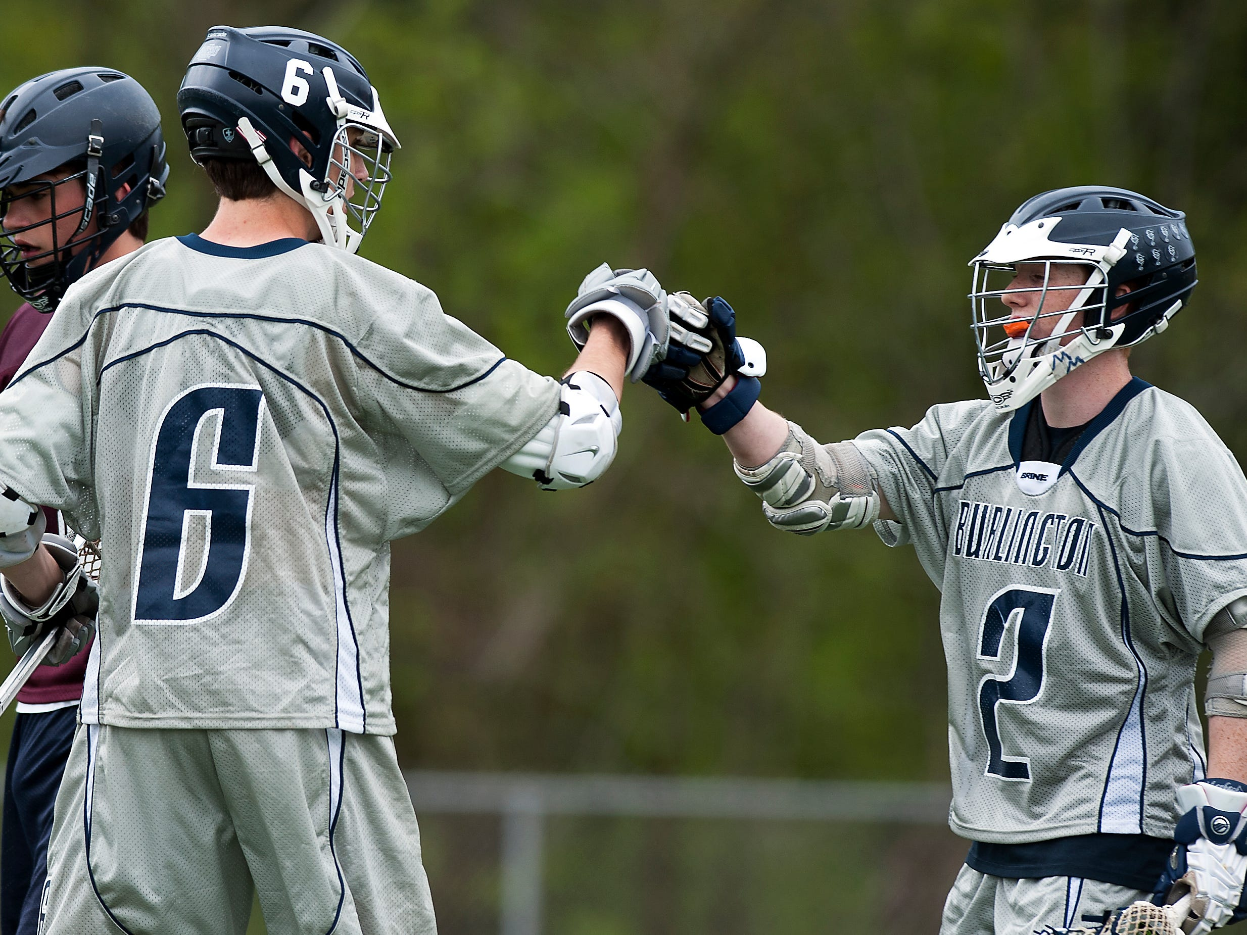 Two Burlington players celebrate a goal during a game against Mount Abraham last year at Buck Hard Field.