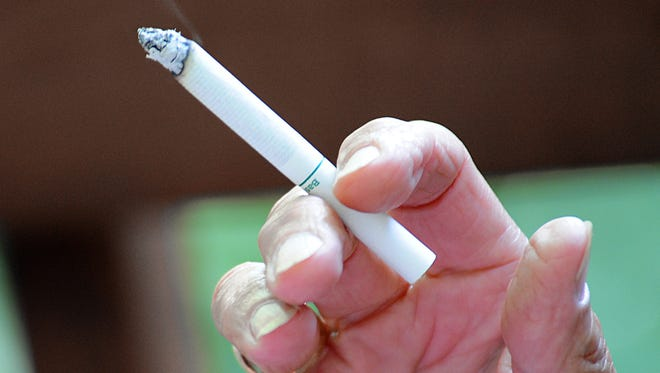 A smoker has a cigarette in 2009 in Hudson, Wis.