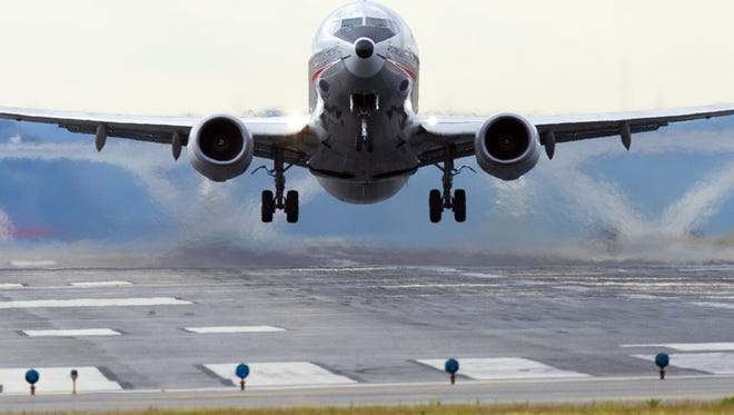 A Boeing 737 airplane takes off from a runway at Ronald Reagan Washington National Airport in Arlington, Virginia, on Monday.