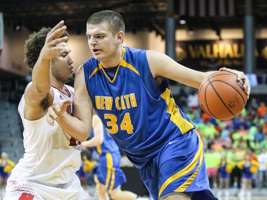 NewCath's Drew McDonald drives baseline on Holmes's Andrew Arnold during the first quarter of their game at NKU Feb. 13.