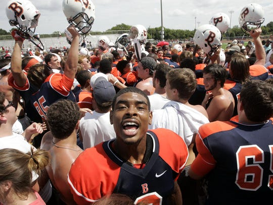 Blackman quarterback Jauan Jennings celebrates with