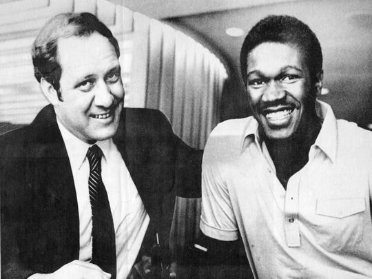 First-round draft choice Herb Williams, right, signs a multi-year contract with the Pacers July 5, 1981 with general manager Bob Salyers.