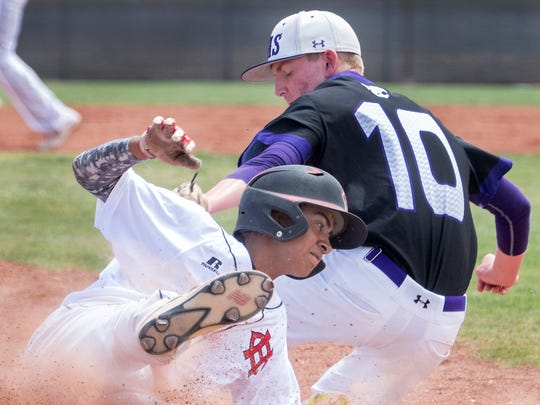 Centennial's Fernando Loera gets by the tag of Clovis third baseman Connor Langrell Saturday morning in the first round of the Class 6A state baseball tournament at the Field of Dreams Baseball Complex.