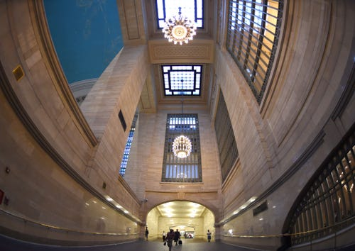 Commuters walk up the ramp to the main concourse in Grand Central Terminal beneath chandeliers. (Photo: Timothy A. Clary, AFP/Getty Images)