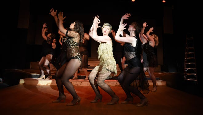 "Tracy Webber (center) as ""Velma"" and cast members perform in Pentacle Theatre's this year's hit production of ""Chicago."" 2016 season tickets, which includes the musical ""9 to 5"" and ""Urinetown,"" are on sale."