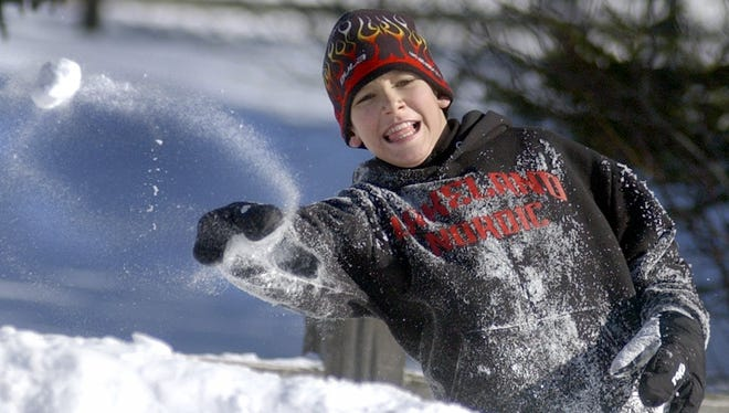 In this 2004 file photo, Kevin Bolger takes aim at a friend as he and others enjoy a snowball fight to pass the time at the Nine Mile Recreation Area.