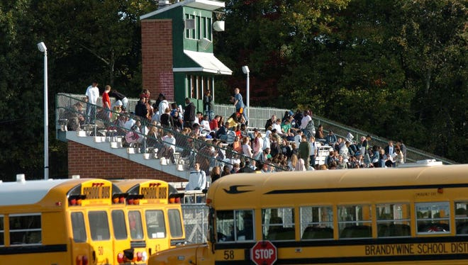 Mount Pleasant High School students evacuated the school and wait in the bleacher stands outside while Delaware State Police search the school after receiving a bomb threat in 2016.