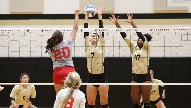 Anderson University's Serena Jackson (7) and Jayln Knight (17) go up for a block during action this year.
