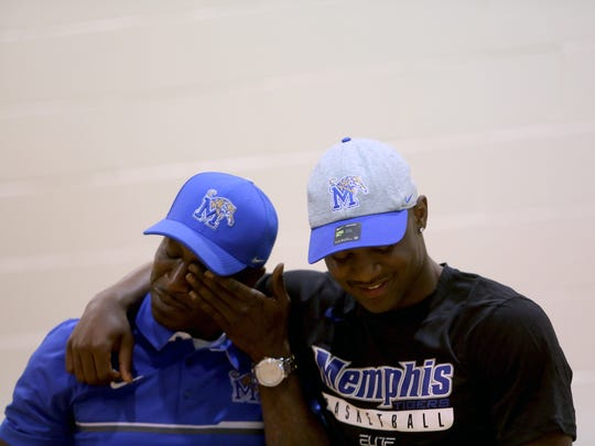 April 11, 2018 - East High School point guard Alex Lomax hugs his father, Alex Lomax, left, after signing his national letter of intent to attend University of Memphis during an event at Lester Community Center on Wednesday.